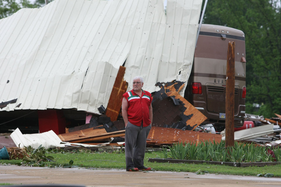 Photo - Hal Hicks waits for his insurance agent outside his tornado-damaged home in the Brewer community near Tupelo, Miss.  on Wednesday, April 27, 2011.  Another night of severe weather has left four people dead in Mississippi, including a Louisiana police officer who was out camping with his daughter, raising the state's total death toll to at least five.  (AP Photo/The Northeast Mississippi Daily Journal, C. Todd Sherman)