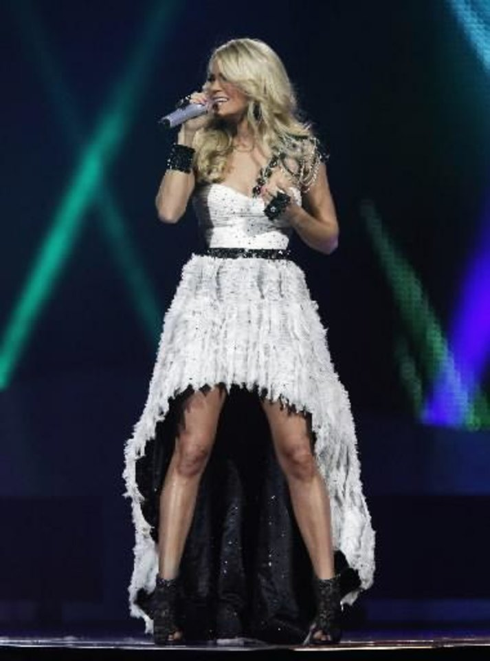 Photo -  Carrie Underwood performs an October 2012 show at Oklahoma City's Chesapeake Energy Arena. Photo by Garett Fisbeck, The Oklahoman Archives
