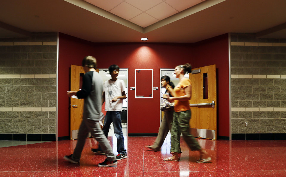 People walk the halls of the new building for freshmen during the Mustang High School open house on Monday. Photo by Nate Billings, The Oklahoman NATE BILLINGS - THE OKLAHOMAN