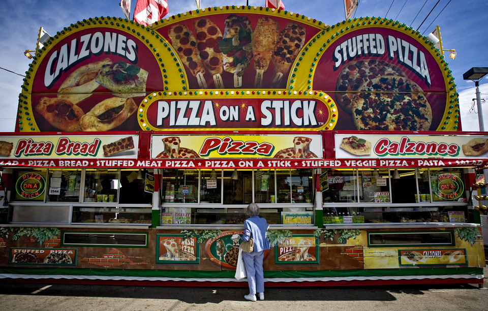 Photo - Dorothea Lewis gets a lemonade from the Pizza on a Stick stand at the 2009 Oklahoma State Fair at State Fair Park on Wednesday, Sept. 23, 2009, in Oklahoma City, Okla.  Photo by Chris Landsberger, The Oklahoman.