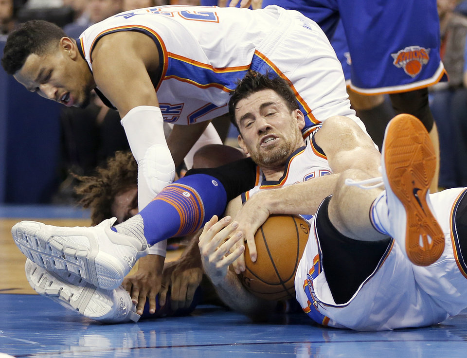 Photo - Oklahoma City's Nick Collison (4), right, Andre Roberson (21) and New York's Robin Lopez (8) try to secure a loose ball during an NBA basketball game between the Oklahoma City Thunder and the New York Knicks at Chesapeake Energy Arena in Oklahoma City, Friday, Nov. 20, 2015. New York won 93-90. Photo by Nate Billings, The Oklahoman