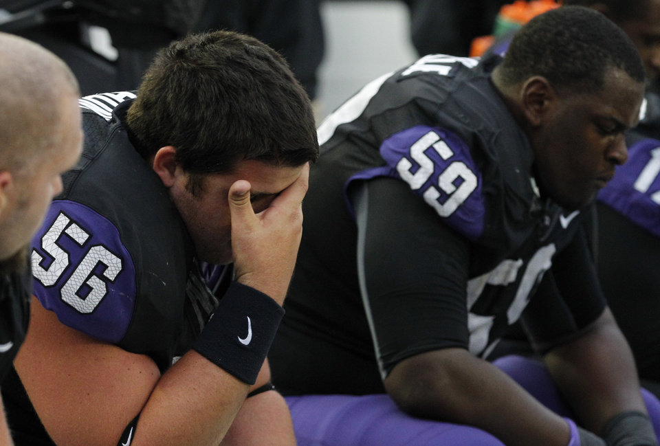 Photo -   TCU center Joey Hunt (56) sits on the bench with offensive tackle Tayo Fabuluje (59) during the final seconds of an NCAA college football game against Iowa State, Saturday, Oct. 6, 2012, in Fort Worth, Texas. Iowa State won 37-23. (AP Photo/LM Otero)