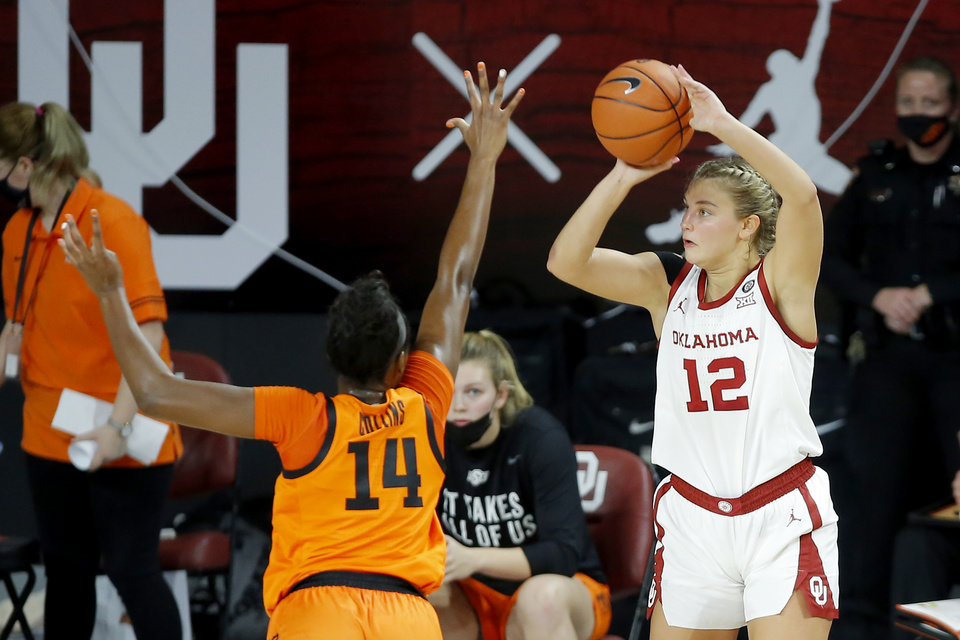 Photo - Oklahoma's Gabby Gregory (12) shoots over Oklahoma State's Taylen Collins (14)  during a Bedlam women's college basketball game between the University of Oklahoma (OU) and Oklahoma State University (OSU) at Lloyd Noble Center in Norman, Okla., Tuesday, Dec. 15, 2020. [Bryan Terry/The Oklahoman]