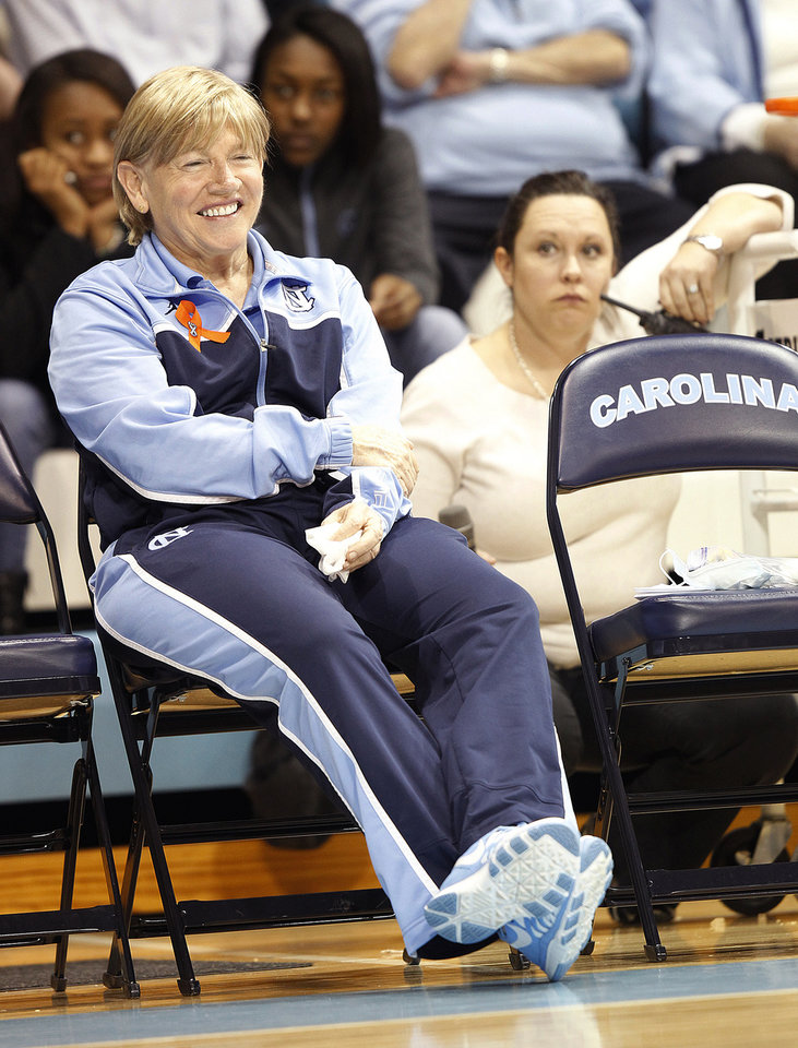 Photo - North Carolina head coach Sylvia Hatchell prepares to address the crowd at halftime of an NCAA women's college basketball game against Maryland, Sunday, Jan. 5, 2014, in Chapel Hill, N.C. The Hall of Fame coach has been out all year while she receives treatment for leukemia. (AP Photo/Ellen Ozier)