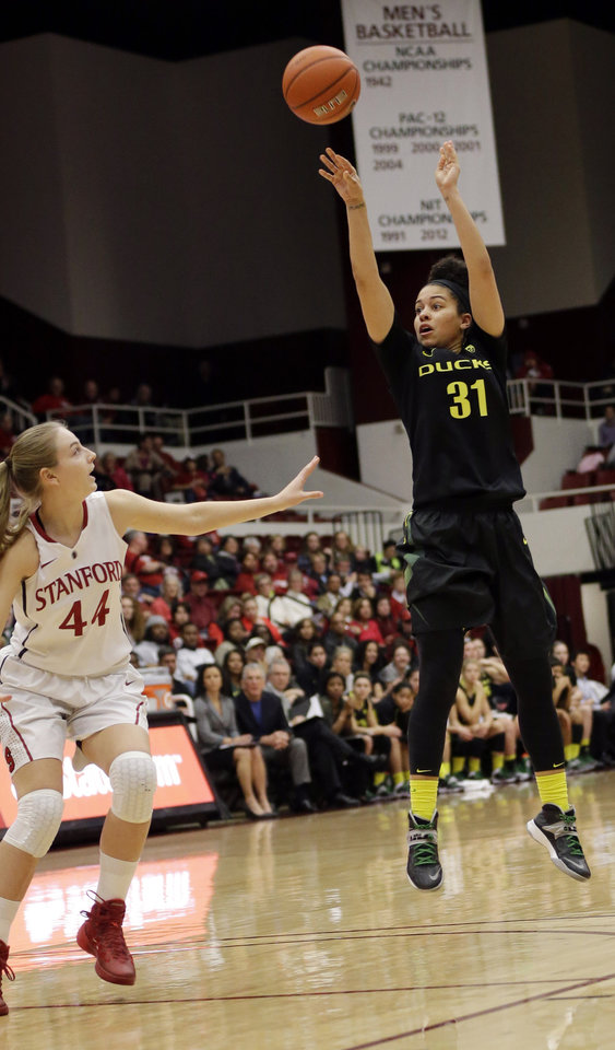 Photo - Oregon's Katelyn Loper (31) shoots over Stanford 's Karlie Samuelson (44) during the first half of an NCAA college basketball game on Friday, Jan. 3, 2014, in Stanford, Calif. (AP Photo/Marcio Jose Sanchez)