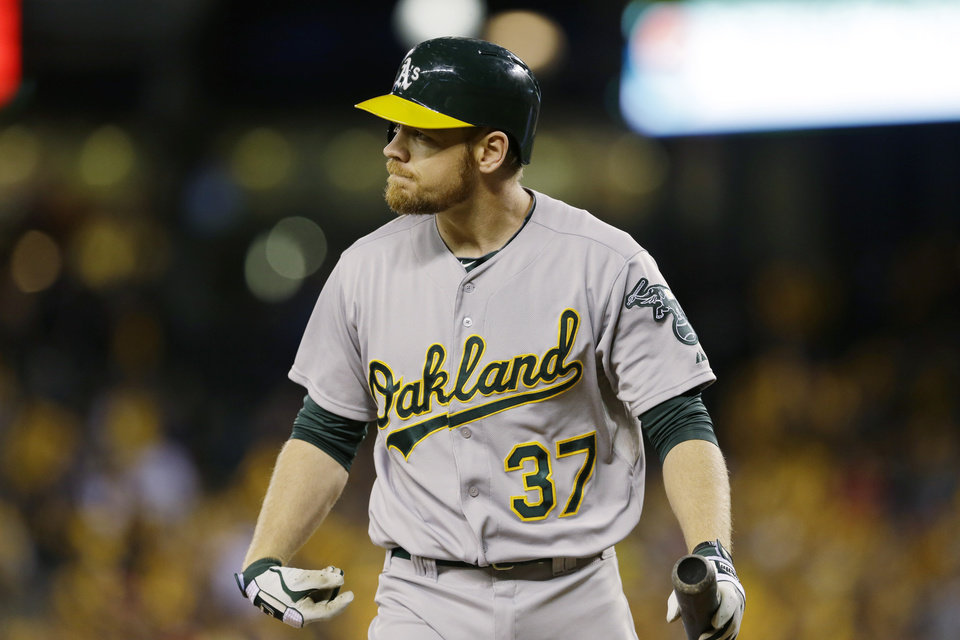 Photo - Oakland Athletics' Brandon Moss looks toward the mound after he struck out swinging against Seattle Mariners starting pitcher Felix Hernandez in the fourth inning of a baseball game, Friday, April 11, 2014, in Seattle. (AP Photo/Ted S. Warren)
