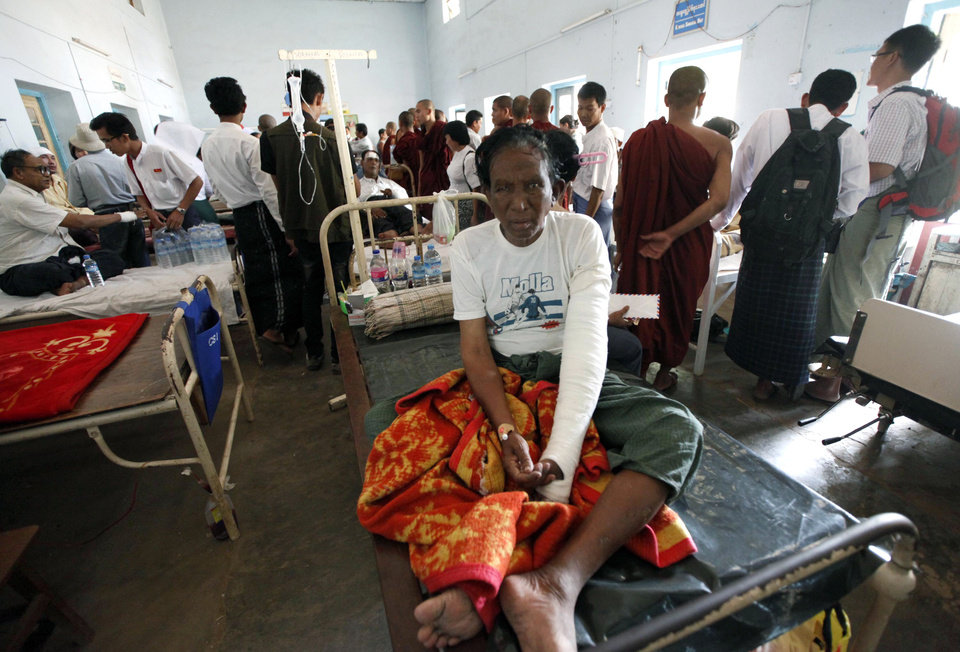 People injured during ethnic unrest between Buddhists and Muslims receive medical treatment at a hospital in Meikhtila, Mandalay division, about 550 kilometers (340 miles) north of Yangon, Myanmar, Saturday, March 23, 2013. Myanmar\'s army took control of the ruined central city on Saturday, regaining control after several days of clashes between Buddhists and Muslims that killed dozens of people and left scores of buildings in flames in the worst sectarian bloodshed to hit the Southeast Asian nation this year.(AP Photo/Khin Maung Win)