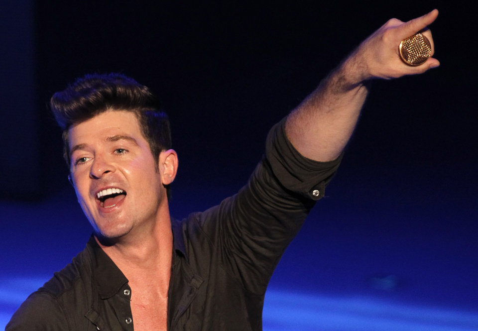 Photo - FILE - In this Sept. 7, 2012 file photo, musician Robin Thicke performs during Macy's Passport presents Glamorama 2012 at The Orpheum Theatre in Los Angeles. Thicke's