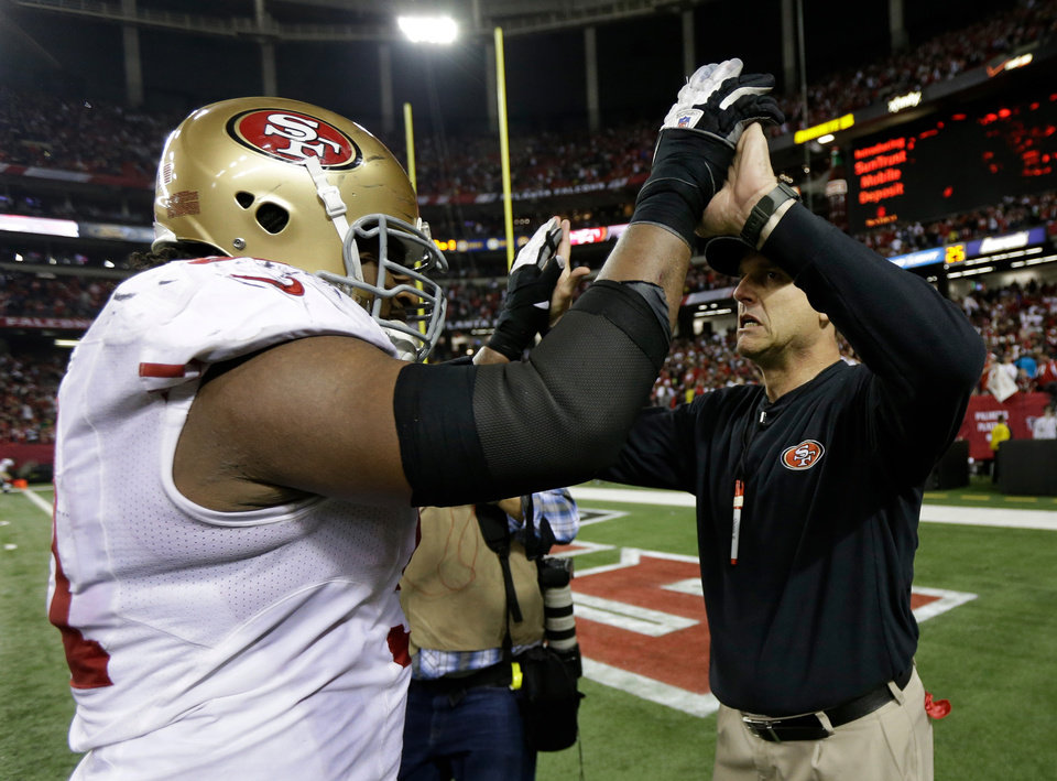 San Francisco 49ers head coach Jim Harbaugh celebrates with Ray McDonald after the NFL football NFC Championship game against the Atlanta Falcons Sunday, Jan. 20, 2013, in Atlanta. The 49ers won 28-24 to advance to Super Bowl XLVII. (AP Photo/Mark Humphrey)