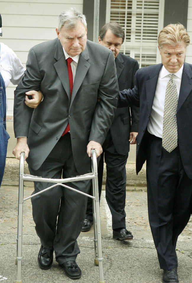 Photo - Former State Senator Gene Stipe is assisted toward the Ed Edmondson Federal Courthouse in Muskogee, Okla., Thursday, June 28, 2007 by his attorney Clark Brewster as he appears in court to answer a probation revocation petition. Photo by Paul Hellstern / The Oklahoman. ORG XMIT: KOD