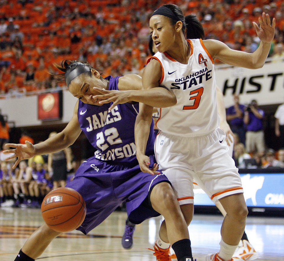 OSU's Tiffany Bias (3) knocks the ball away from James Madison's Tarik Hislop (22) during the Women's NIT championship college basketball game between Oklahoma State University and James Madison at Gallagher-Iba Arena in Stillwater, Okla., Saturday, March 31, 2012. Photo by Nate Billings, The Oklahoman