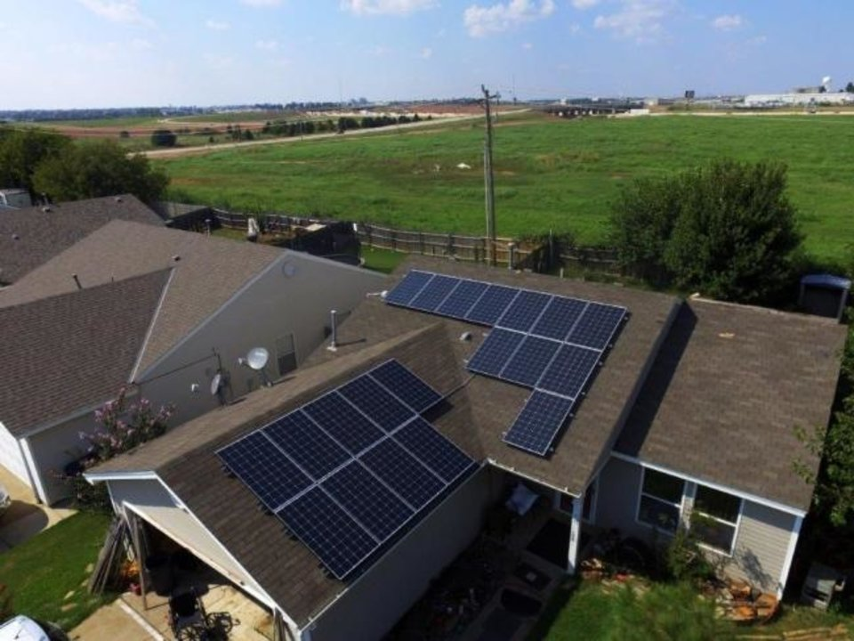 Photo -  Solar Power of Oklahoma installed a system on this home in Yukon recently. The average capacity of a solar system it installs on homes is 7 killowatts, officials say. [PROVIDED BY SOLAR POWER OF OKLAHOMA]