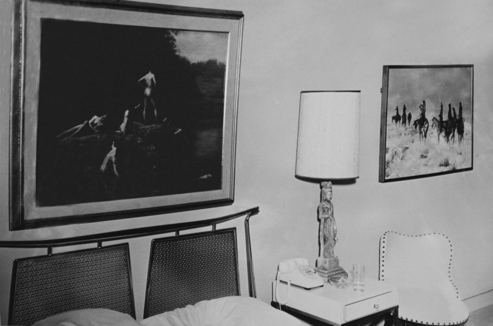 Photo -   This Nov. 22, 1963 photo provided by Amon Carter Museum of American Art Archives shows the paintings Thomas Eakins', Swimming and Charles M. Russell's, Lost in a Snowstorm in Suite 850 at the Hotel Texas, in Fort Worth, Texas. An exhibit opening next year at the Dallas Museum of Art will feature almost all of the works of art gathered from museums and prominent Fort Worth citizens for the hotel suite John F. Kennedy and first lady Jacqueline Kennedy stayed in the night before he was assassinated. (AP Photo/ Amon Carter Museum of American Art Archives, Byron Scott)