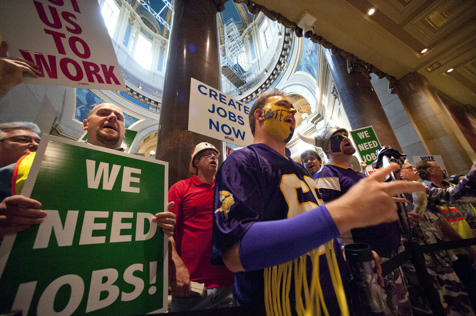 Photo -   Construction workers and Vikings fans gather at Minnesota's Capitol in St. Paul, Minn., on Monday, May 7, 2012, urging legislators to approve a proposed $975 million stadium for the team. The House is scheduled to begin debating the stadium later in the day. (AP Photo/The Star Tribune, Glen Stubbe) MANDATORY CREDIT; ST. PAUL PIONEER PRESS OUT; MAGS OUT; TWIN CITIES TV OUT