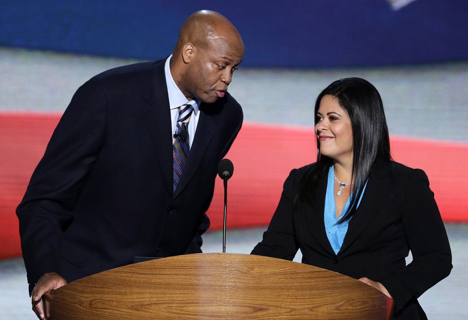 Photo - Craig Robinson, First Lady Michelle Obama's brother and Maya Soetoro-ng, President Barack Obama's sister address the Democratic National Convention in Charlotte, N.C., on Tuesday, Sept. 4, 2012. (AP Photo/J. Scott Applewhite)  ORG XMIT: DNC170