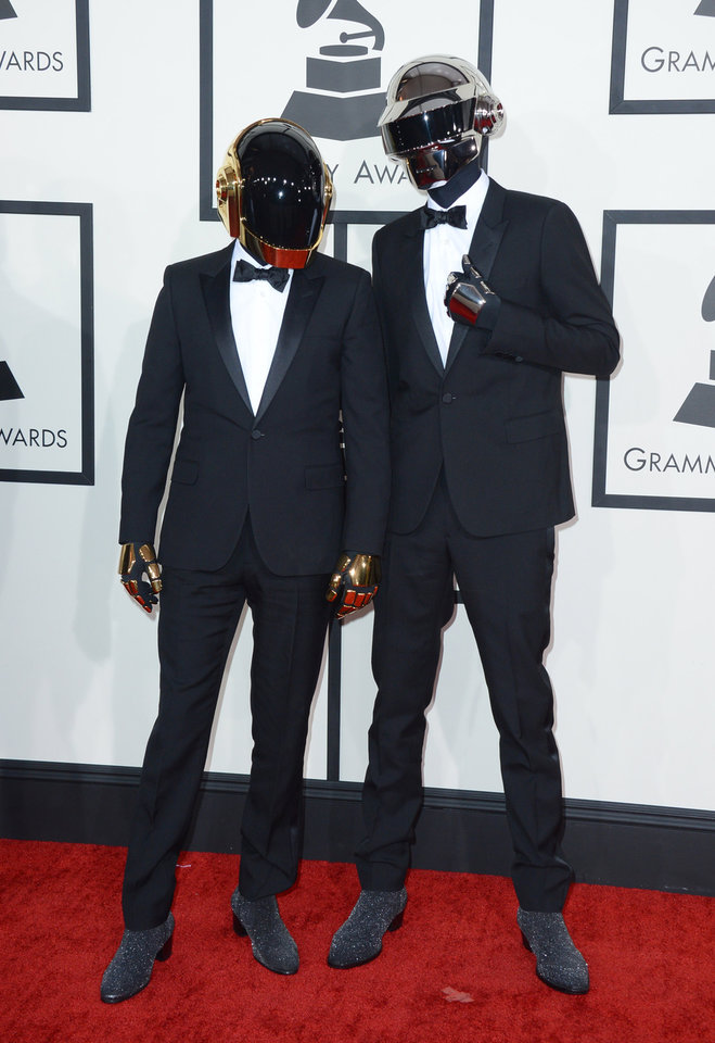 Photo - Daft Punk arrives at the 56th annual Grammy Awards at Staples Center on Sunday, Jan. 26, 2014, in Los Angeles. (Photo by Jordan Strauss/Invision/AP)