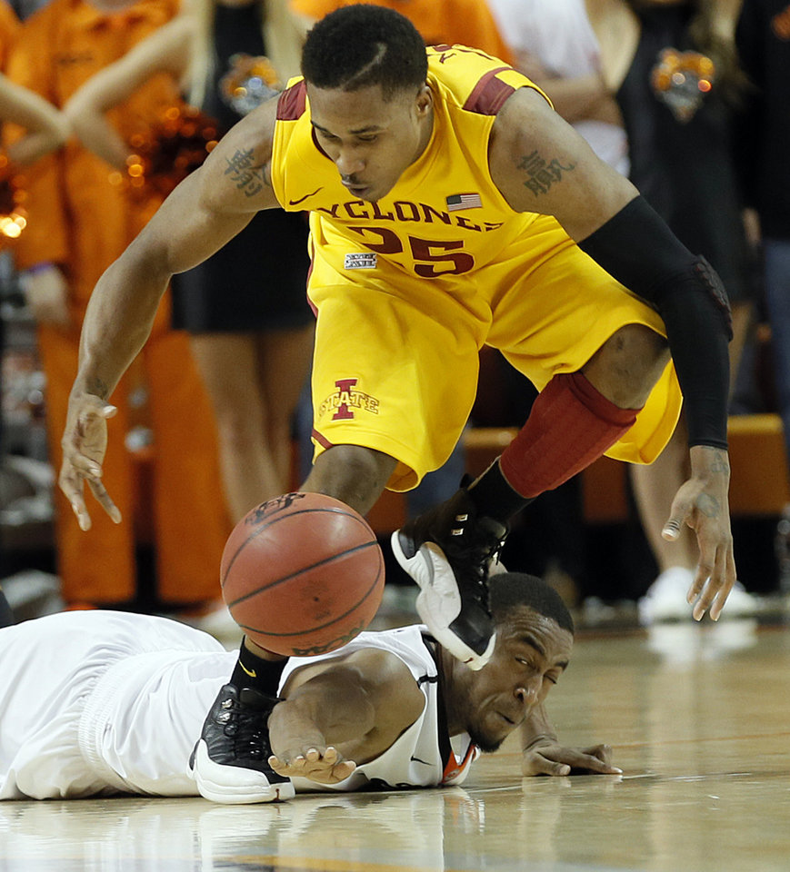 Photo - Oklahoma State Cowboys' Markel Brown (22) fights for a loose ball with Iowa State Cyclones' Tyrus McGee (25) during the college basketball game between the Oklahoma State University Cowboys (OSU) and the Iowa State University Cyclones (ISU) at Gallagher-Iba Arena on Wednesday, Jan. 30, 2013, in Stillwater, Okla.  Photo by Chris Landsberger, The Oklahoman