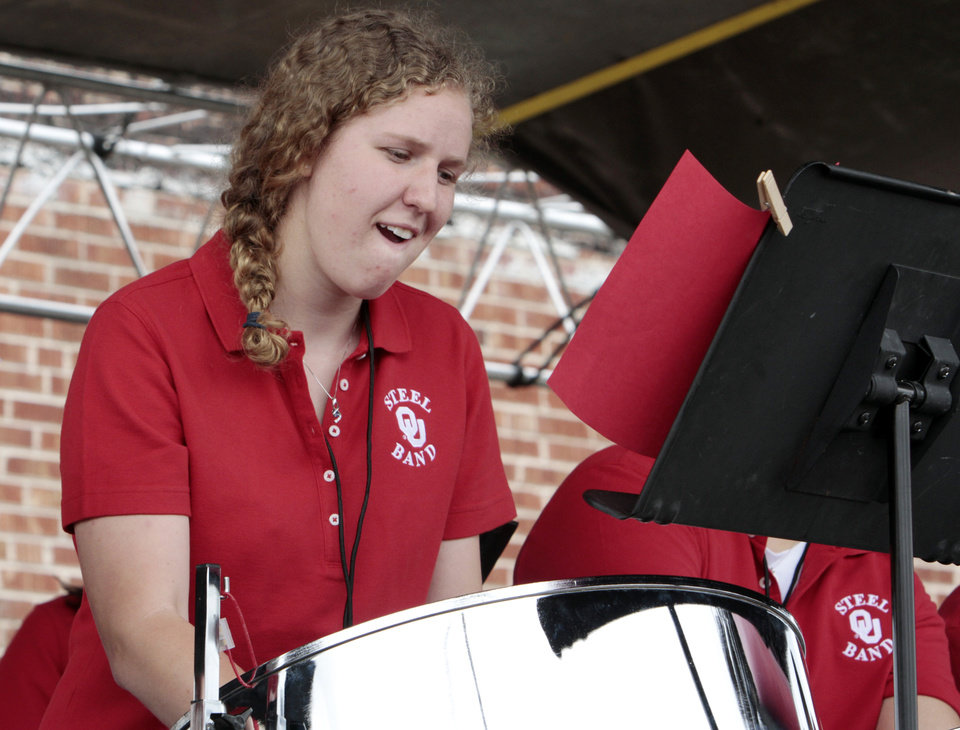 Photo - Members of the University of Oklahoma Steel Band play steel drums during the Norman Music Festival on Saturday, April 28, 2012, in Norman, Okla.  Photo by Steve Sisney, The Oklahoman