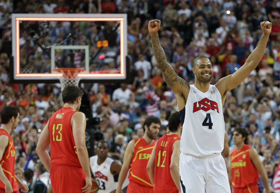 Photo - United States' Tyson Chandler celebrates after a men's gold medal basketball game against Spain at the 2012 Summer Olympics, Sunday, Aug. 12, 2012, in London. USA won 107-100. (AP Photo/Eric Gay)