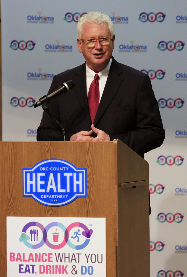 Photo -  Gary Cox, Executive Director of the OKC-County Health Department speaks as the Oklahoma Beverage Association launches the
