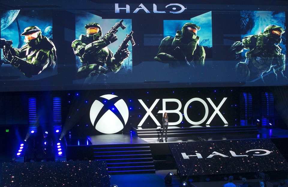 Photo -  Bonnie Ross, General Manager of 343 Industries, Microsoft Games Studios, presents Halo for the Xbox One, during a presentation ahead of the Electronic Entertainment Expo at the University of Southern California's Galen Center on Monday in Los Angeles. With the launch of the Xbox One, PlayStation 4 and Wii U in the video game industry's rearview mirror, the spotlight at E3 is expected to shift back to games. AP Photo   Damian Dovarganes -  AP