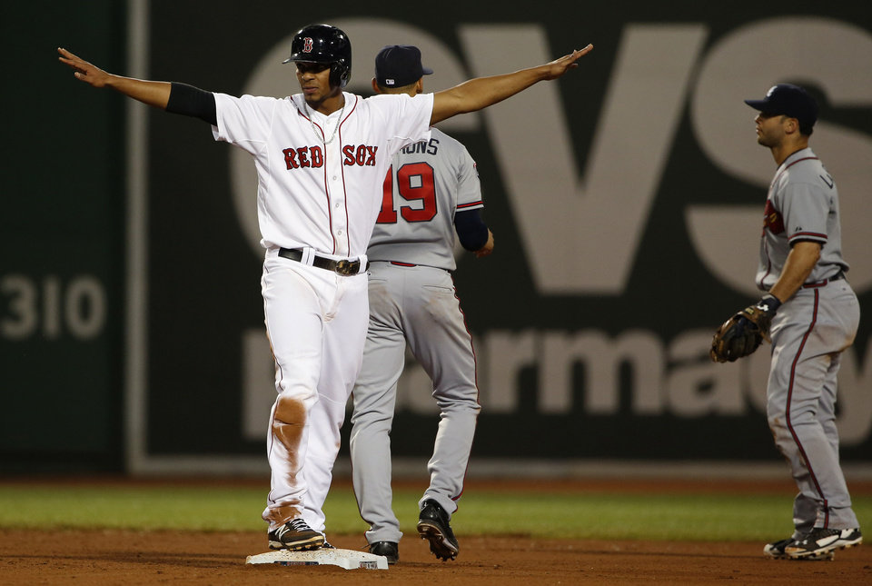 Photo - Boston Red Sox's Xander Bogaerts signals safe after Atlanta Braves second baseman Tommy La Stella, right, couldn't handle an infield hit by Dustin Pedroia during the eighth inning of a baseball game at Fenway Park, Thursday, May 29, 2014, in Boston. (AP Photo/Winslow Townson)