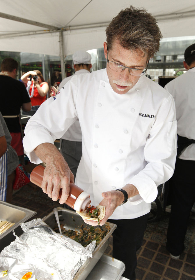 Photo - Chef Rick Bayless preparing fresh grilled tacos being served at Leadership Square during OK Chefs Relief's latest fundraiser for tornado recovery.  PAUL B. SOUTHERLAND - PAUL B. SOUTHERLAND