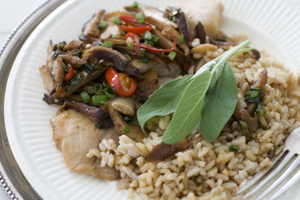 In this image taken on Dec. 3, 2012, Chinese-styled steamed tilapia is shown served on a plate in Concord, N.H. (AP Photo/Matthew Mead)