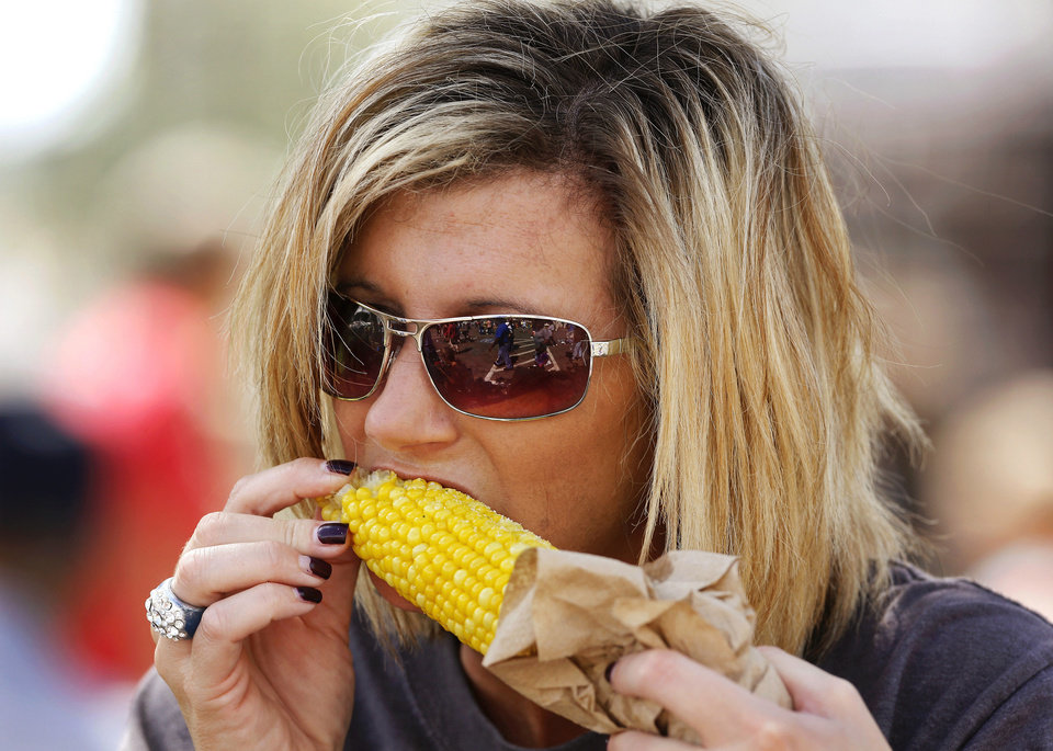 Crystal Wilkerson of Deer Creek bites into an ear of roasted corn  at the Oklahoma State Fair on Wednesday,  Sep. 18, 2013. Wilkerson attended the fair with about a dozen residents from the Grace Living Center in Bethany, where Wilkerson works as a social worker. Photo  by Jim Beckel, The Oklahoman.