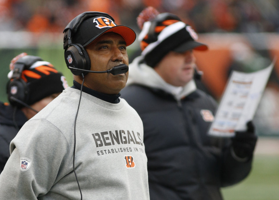 Photo - Cincinnati Bengals head coach Marvin Lewis watches from the sidelines in the first half of an NFL football game against the Indianapolis Colts, Sunday, Dec. 8, 2013, in Cincinnati. (AP Photo/David Kohl)