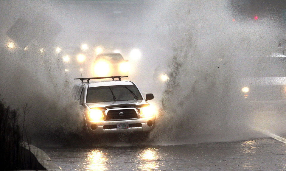 Photo -   Traffic plows through high water as it merges onto Interstate 5 in Portland, Ore., Monday, Nov. 19, 2012. A powerful storm is pounding the Oregon coast, shutting down marine traffic in and out of several coastal rivers and closing part of highway U.S. 101. (AP Photo/Don Ryan)