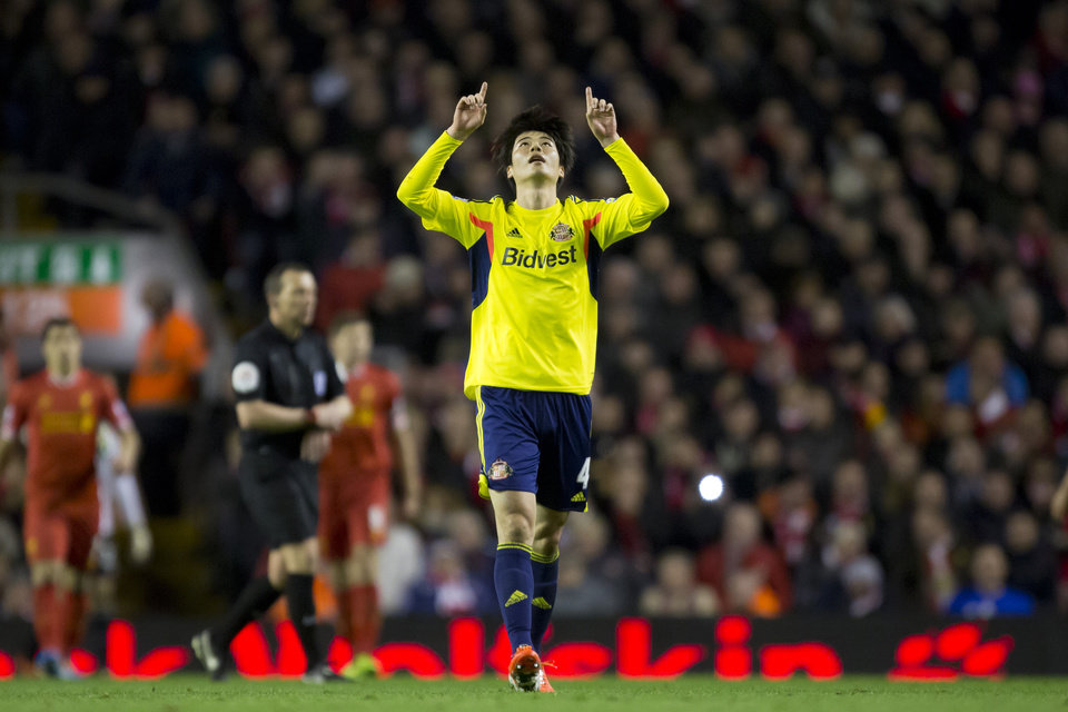 Photo - Sunderland's Ki Sung-Yueng celebrates after scoring against Liverpool during their English Premier League soccer match at Anfield Stadium, Liverpool, England, Wednesday, March 26, 2014. (AP Photo/Jon Super)