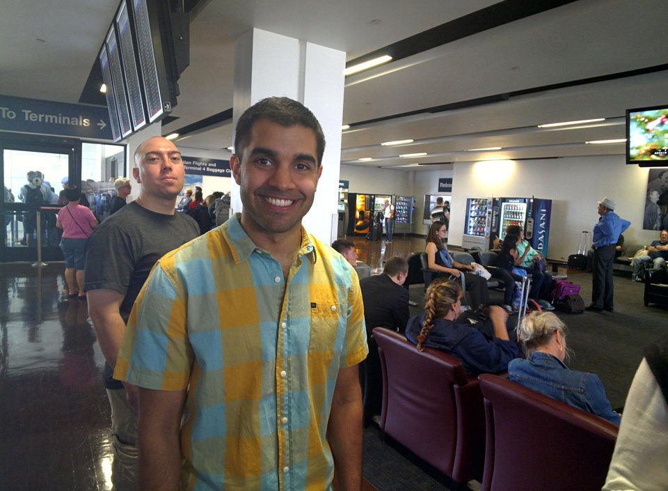 Photo - In this photo taken with Google Glass, Hiresh Patel, a nuclear medicine technologist in Springfield, Mo., was one of the people at the airport who wanted to try Glass..  PHOTO BY LILLIE-BETH BRINKMAN, TAKEN WITH GLASS.