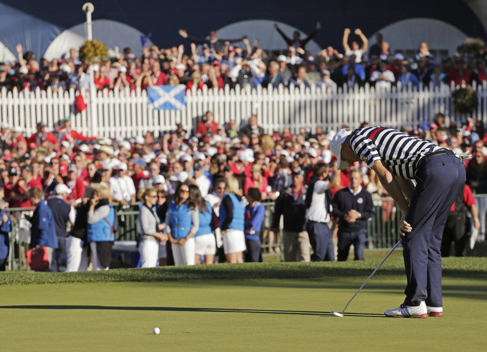 Photo - USA's Jim Furyk reacts after missing a putt on the 18th hole and losing to Europe's Sergio Garcia during a singles match at the Ryder Cup PGA golf tournament Sunday, Sept. 30, 2012, at the Medinah Country Club in Medinah, Ill. (AP Photo/Charlie Riedel)  ORG XMIT: PGA182