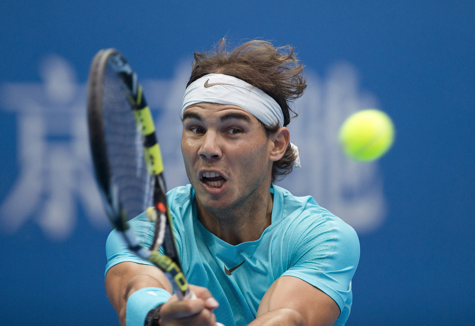 Photo - Rafael Nadal of Spain returns a shot to Novak Djokovic of Serbia during the final of the China Open tennis tournament at the National Tennis Stadium in Beijing, China Sunday, Oct. 6, 2013. (AP Photo/Andy Wong)