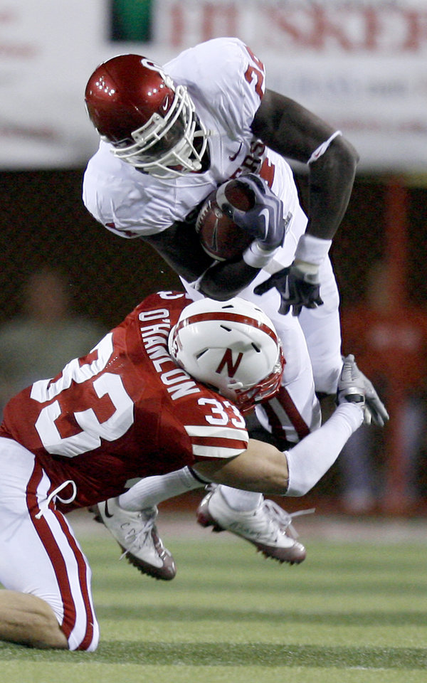 Photo - Nebraska's Matt O'Hanlon (33) tackles OU's Dejuan Miller (24) during the second half of the college football game between the University of Oklahoma Sooners (OU) and the University of Nebraska Cornhuskers (NU) on Saturday, Nov. 7, 2009, in Lincoln, Neb. Photo by Sarah Phipps, The Oklahoman