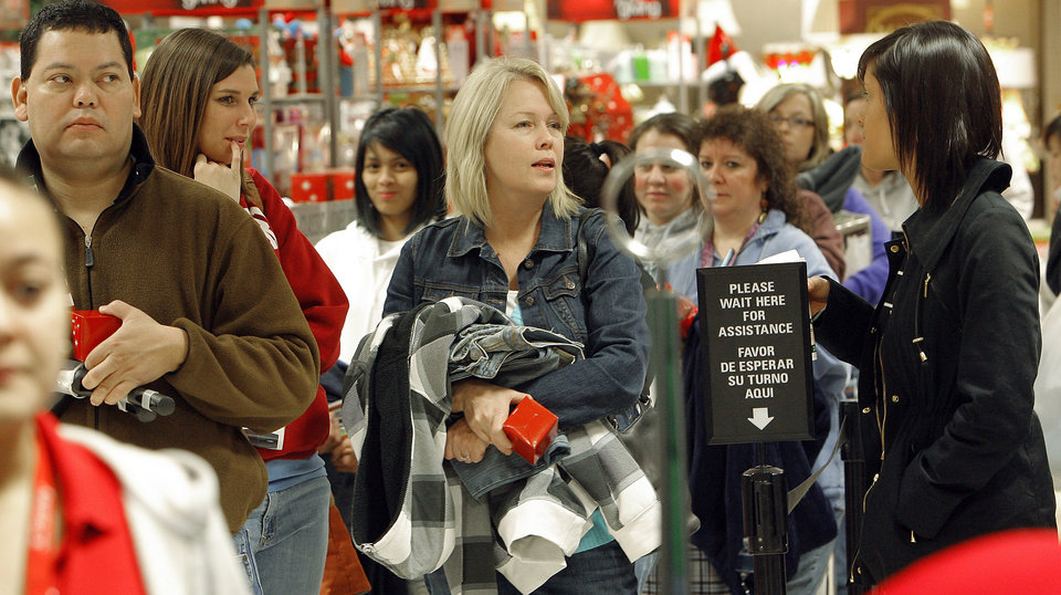 Photo - Black Friday. Line of shoppers checkout at the  J.C. Penney's in Penn Square Mall , Friday, November 27, 2009. The doors opened at 4:00 A.M. By David McDaniel, The Oklahoman.