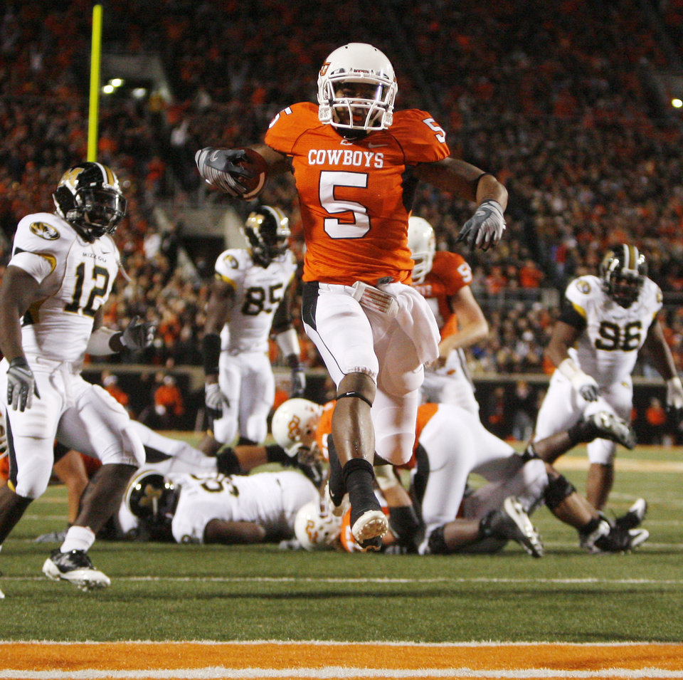 Photo - Keith Toston jumps into the end zone for the Cowboys first TD during the college football game between Oklahoma State University (OSU) and the University of Missouri (MU) at Boone Pickens Stadium in Stillwater, Okla. Saturday, Oct. 17, 2009.  Photo by Sarah Phipps, The Oklahoman