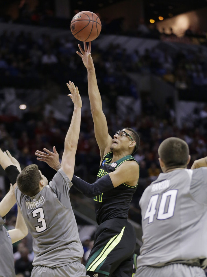 Baylor\'s Isaiah Austin, center, shoots over Creighton\'s Doug McDermott (3) during the first half of a third-round game in the NCAA college basketball tournament Sunday, March 23, 2014, in San Antonio. (AP Photo/Eric Gay)