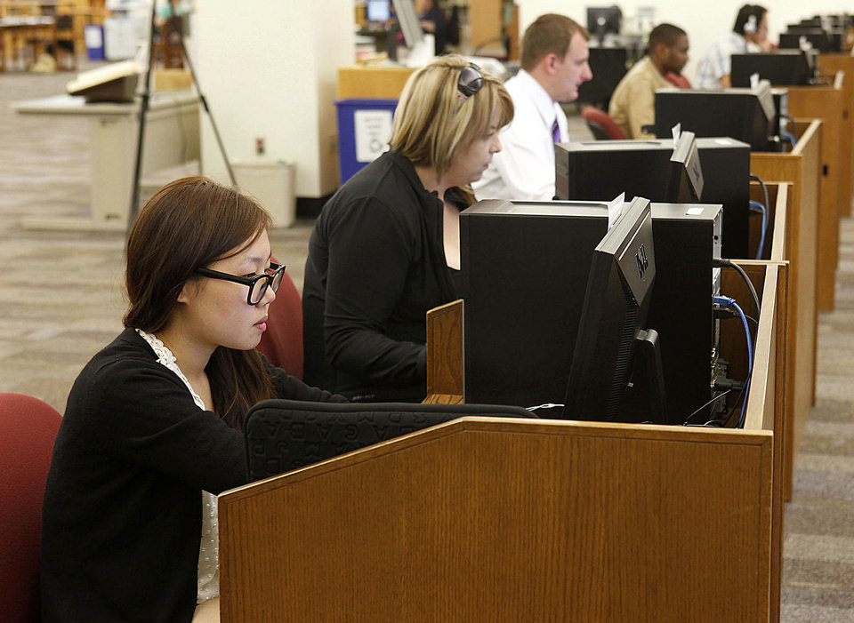 Emma Lee studies for finals in the library at the University of Central Oklahoma in Edmond on Monday. Photo by Paul Hellstern, The Oklahoman PAUL HELLSTERN - Oklahoman