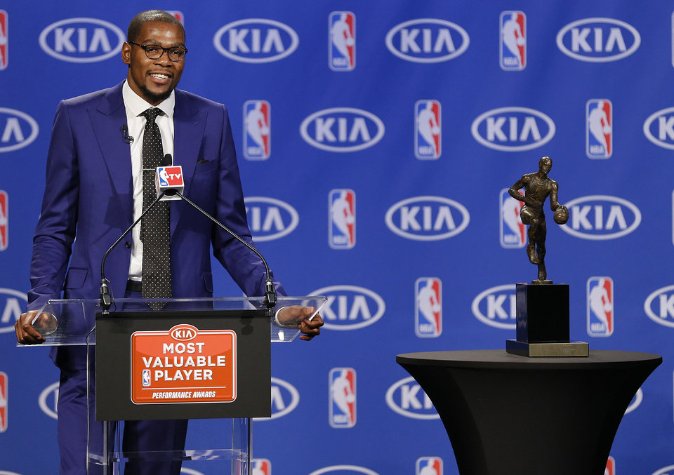 Photo - Kevin Durant is all smiles as he speaks during a news conference announcing Durant as the winner of the 2013-14 Kia NBA Basketball Most Value Player Award in Oklahoma City, Okla. on Tuesday, May 6, 2014. Photo by Chris Landsberger, The Oklahoman