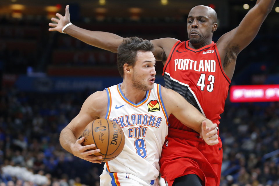 Photo - Oklahoma City's Danilo Gallinari (8) goes past Portland's Anthony Tolliver (43) during an NBA basketball game between the Oklahoma City Thunder and the Portland Trail Blazers at Chesapeake Energy Arena in Oklahoma City, Wednesday, Oct. 30, 2019. [Bryan Terry/The Oklahoman]