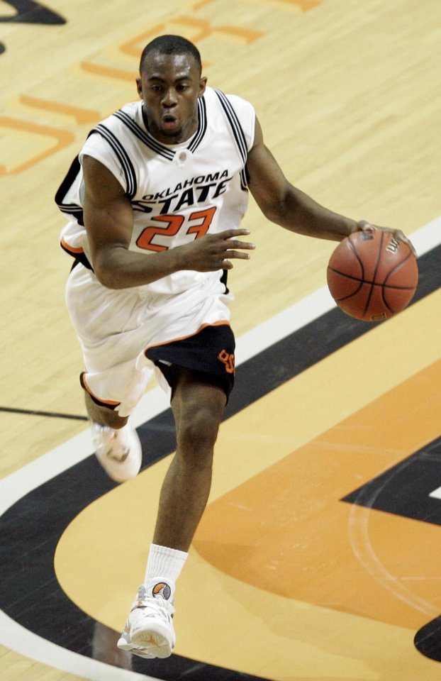Photo - OSU's James Anderson (23) brings the ball upcourt in the first half during the college basketball exhibition game between Oklahoma State University and East Central University at Gallagher-Iba Arena in Stillwater, Okla., Tuesday, Nov. 6, 2007. BY MATT STRASEN, THE OKLAHOMAN ORG XMIT: KOD