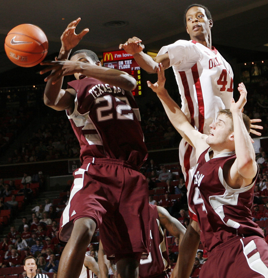 OU's Ray Willis (41) chases the ball along with Khris Middleton (22) and Nathan Walkup (45) of Texas A&M in the second half during the men's college basketball game between the Oklahoma Sooners and Texas A&M Aggies at Lloyd Noble Center in Norman, Okla., Saturday, March 6, 2010. Texas A&M won, 69-54. Photo by Nate Billings, The Oklahoman