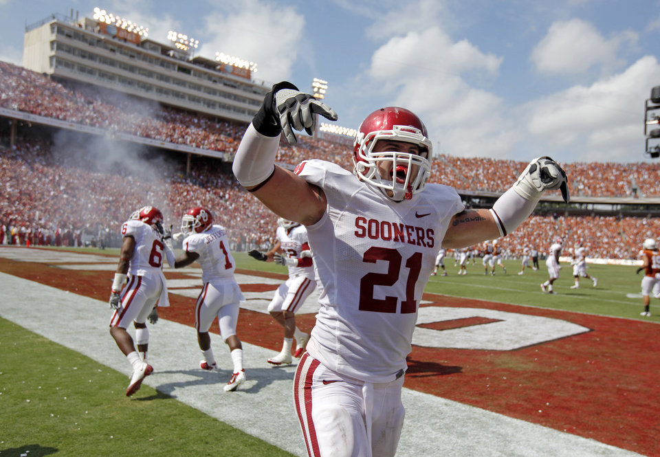 Oklahoma's Tom Wort (21) celebrates after a touchdown by Oklahoma's Demontre Hurst (6) during the Red River Rivalry college football game between the University of Oklahoma Sooners (OU) and the University of Texas Longhorns (UT) at the Cotton Bowl in Dallas, Saturday, Oct. 8, 2011. Photo by Bryan Terry, The Oklahoman
