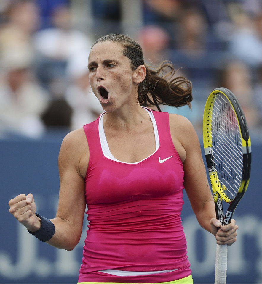 Photo -   Italy's Roberta Vinci reacts during her match against Agnieszka Radwanska, of Poland, in the fourth round of play at the 2012 US Open tennis tournament, Monday, Sept. 3, 2012, in New York. (AP Photo/Henny Ray Abrams)