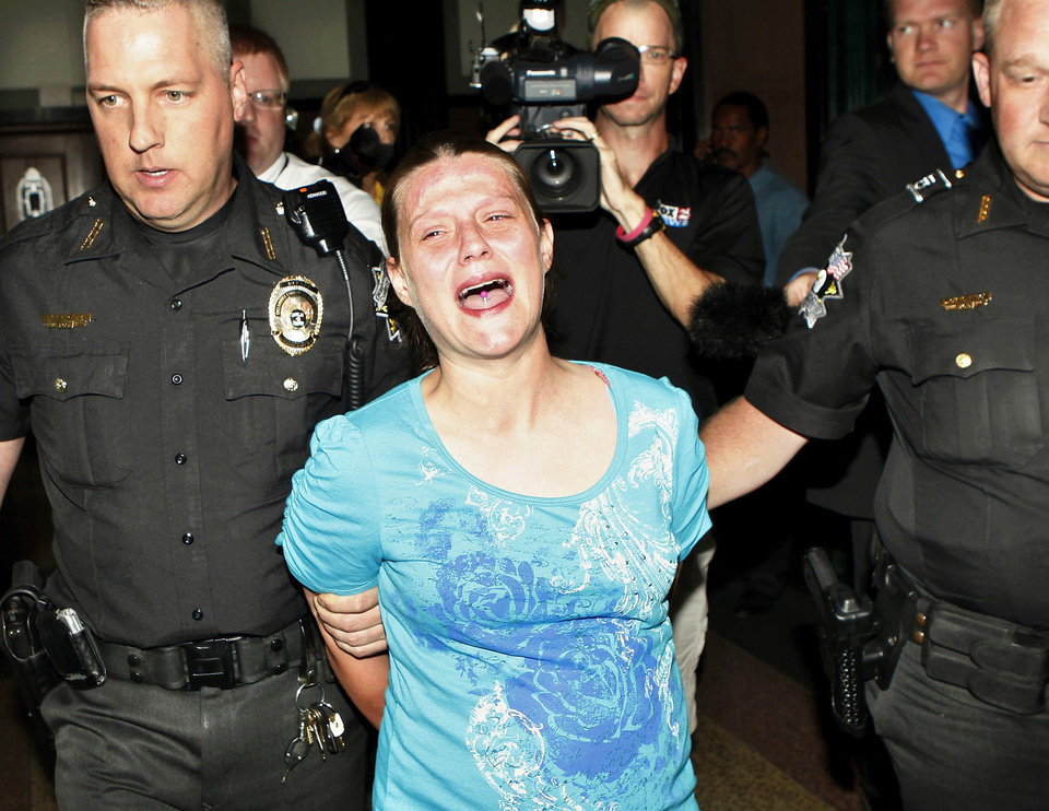 Photo - Stephanie Dunham reacts as she is taken from an Oklahoma County courtroom Wednesday after being sentenced for her part in the deaths of her three children in a 2011 motor home fire. PHOTO BY JIM BECKEL, THE OKLAHOMAN