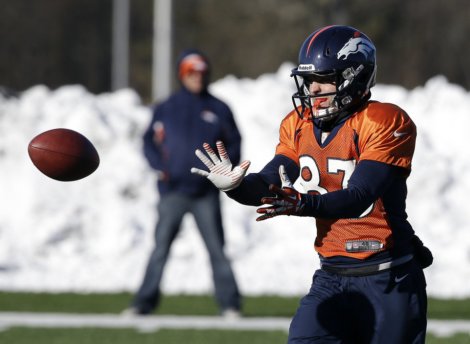 Photo - Denver Broncos wide receiver Wes Welker (83) catches a pass during practice Wednesday, Jan. 29, 2014, in Florham Park, N.J. The Broncos are scheduled to play the Seattle Seahawks in the NFL Super Bowl XLVIII football game Sunday, Feb. 2, in East Rutherford, N.J. (AP Photo/Mark Humphrey)