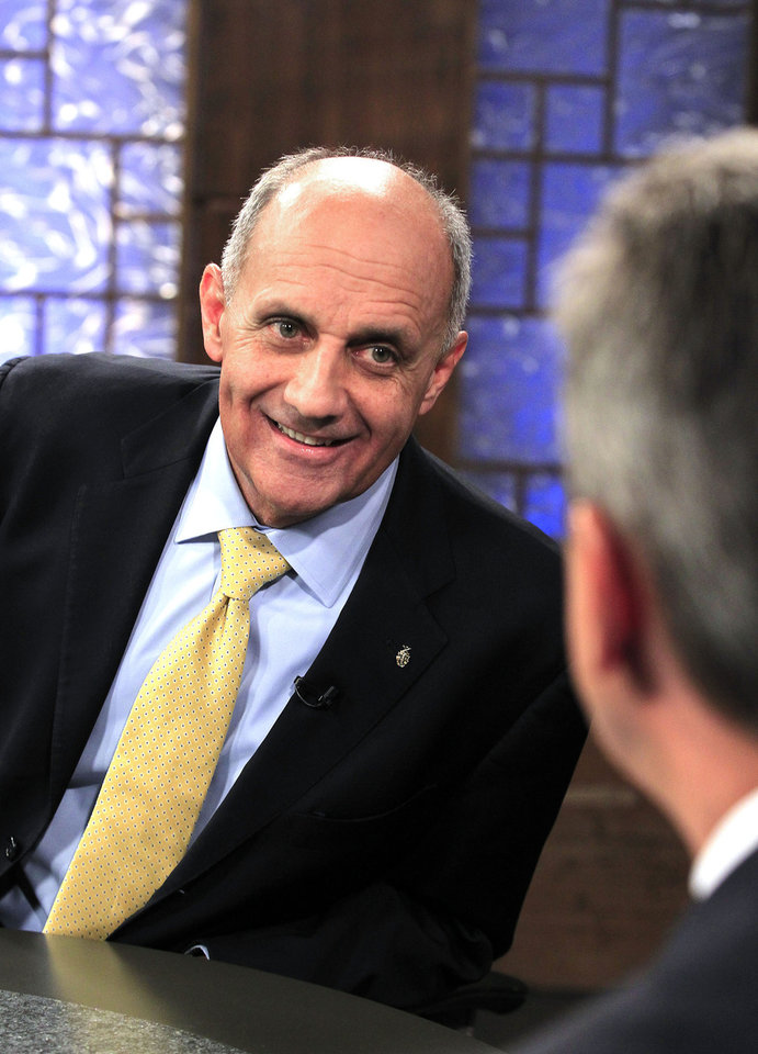 Democrat Richard Carmona, left, talks with moderator Ted Simons, host and managing editor of Arizona Horizon at Eight, Arizona PBS, as they meet in studio prior to an Arizona U.S. Senate debate against Rep. Jeff Flake, R-Ariz., and Libertarian Marc Victor Wednesday, Oct. 10, 2012, in Phoenix. The two are vying for the seat left open by retiring Sen. Jon Kyl, R-Ariz.(AP Photo/Ross D. Franklin)