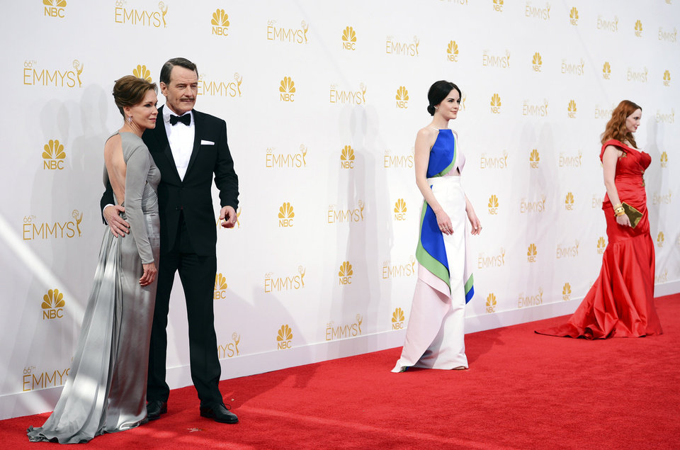 Photo - Robin Dearden, from left, Bryan Cranston, Michelle Dockery and Christina Hendricks arrive at the 66th Annual Primetime Emmy Awards at the Nokia Theatre L.A. Live on Monday, Aug. 25, 2014, in Los Angeles. (Photo by Jordan Strauss/Invision/AP)